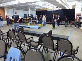Team playing Recycle Rush with chairs, mats and human robots.
